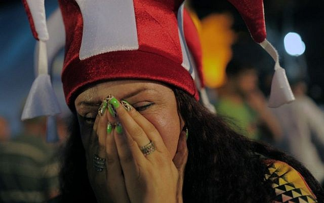 A Turkish woman reacts in Sultan Ahmed Square in Istanbul, Turkey, on Saturday, September 7, 2013 on seeing the results of the Olympics vote. (photo credit: AP Photo)