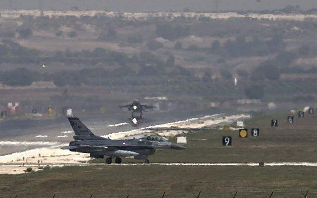A US Air Force plane takes off as a Turkish Air Force fighter jet taxis at the Incirlik airbase, southern Turkey, Sunday, Sept. 1, 2013. (photo credit: AP/Vadim Ghirda)