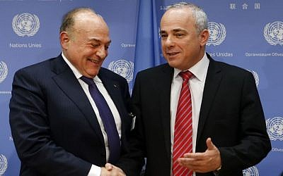 File: Palestinian Finance Minister Shukri Bishara, left, shakes hands with Israeli Intelligence Minister Yuval Steinitz after a press conference regarding a meeting of the Ad Hoc Liaison Committee during the 68th session of the United Nations General Assembly at UN headquarters, Wednesday, Sept. 25, 2013. (photo credit: AP Photo/Jason DeCrow)