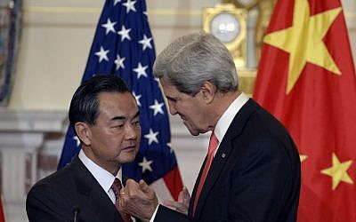 Secretary of State John Kerry, right, and Chinese Foreign Minster Wang Yi, left, talk before making statements before their bilateral meeting at the State Department in Washington, Thursday, Sept. 19, 2013. (Photo credit: AP/Susan Walsh)