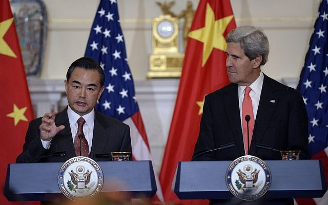 Secretary of State John Kerry (right), listens as Chinese Foreign Minister Wang Yi (left), speaks before their bilateral meeting at the State Department in Washington, Thursday, September 19, 2013. (photo credit: AP/Susan Walsh)