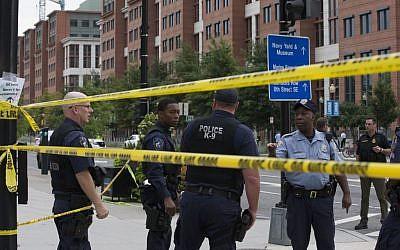 Police work the scene on M Street, SE in Washington near the Washington Navy Yard on Monday, September 16, 2013. (photo credit: AP/Jacquelyn Martin)