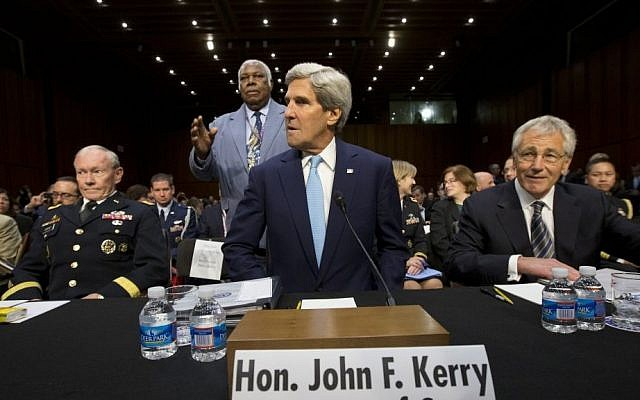 From left to right: Chairman of the Joint Chiefs of Staff Martin Dempsey, US Secretary of State John Kerry and Defense Secretary Chuck Hagel answer questions at a Senate Foreign Relations Committee hearing on Syria in Washington, DC (photo credit: AP/Jacquelyn Martin)