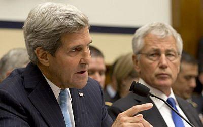 Defense Secretary Chuck Hagel listens at right as Secretary of State John Kerry testifies on Capitol Hill in Washington, September 2013. (photo credit: AP/Jacquelyn Martin)