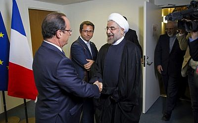 Iranian President Hasan Rouhani, right, meets with French President Francois Hollande during the 68th session of the United Nations General Assembly at United Nations headquarters Tuesday, Sept. 24, 2013 (photo credit: AP/Craig Ruttle)