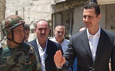 Syrian President Bashar Assad tours the neighborhoods of Daraya, August 1, 2013. (photo credit: Syrian Presidency/Instagram)
