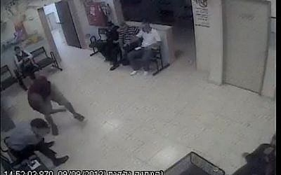 A Jewish man being attacked in a health clinic in Kfar I'blin, September 2013. (screen capture: Youtube/jonatan urich)