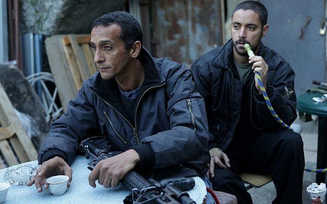 Hitham Omari as Badawi, questioning an unseen Sanfur (Photo credit: Vered Adir/ Courtesy)