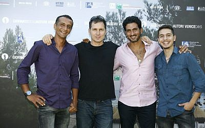 Yuval Adler, second from left, with cast members Hiatham Omari, Tsahi Halevy and Shadi Mar'i at the Venice Film Festival (Photo credit: Moris Puccio/ Courtesy)