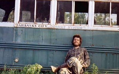 Christopher McCandless outside Alaskan Bus 142 where his body was found. (photo credit: YouTube screenshot)