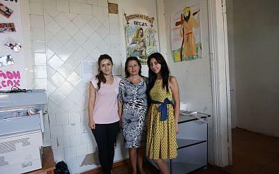 Angela Rubinov, center, with two colleagues from the Jewish nonprofit Atzmaut. (photo credit: Cnaan Liphshiz/JTA)
