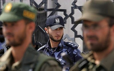 Hamas security forces stand guard in front of the Rafah border crossing in the southern Gaza Strip, on September 16, 2013. (photo credit: Flash90/Abed Rahim Khatib)