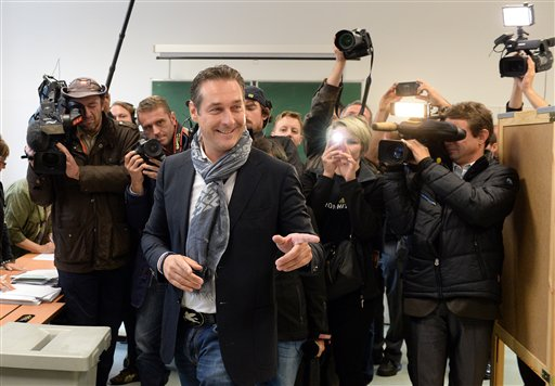 Freedom Party leader Heinz-Christian Strache casts his vote in national elections at a polling station in Vienna, Austria, Sunday, Sept. 29, 2013. (AFP)
