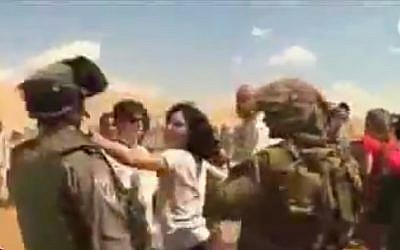 French diplomat Marion Fesneau-Castaing pushing an IDF soldier during the September incident. (Screenshot/YouTube)