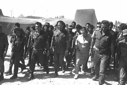 """Meir with Chief of the General Staff Lt. Gen. David Elazar, second from left, and Maj. Gen. Shmuel """"Gorodish"""" Gonen, who was effectively relieved of his command of the southern front during the war (Photo credit: Yitzhak Segev/ GPO)"""