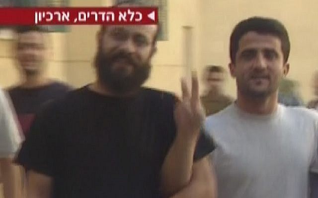 Archive footage: Nur al-Din Amar, brother of Nidal Amar, flashes a victory sign at the camera. (photo credit: screen capture, Channel 2)