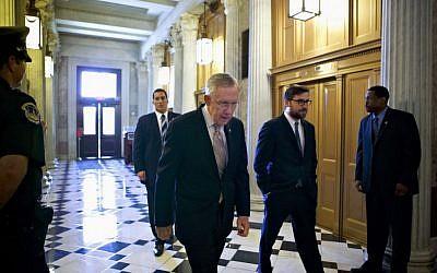 Senate Majority Leader Harry Reid of Nevada makes his way to the Senate floor on Capitol Hill in Washington in September. (photo credit: AP/J. Scott Applewhite)