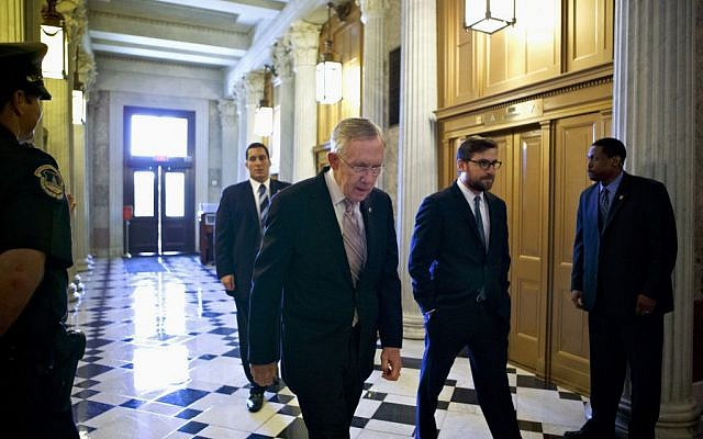 Senate Majority Leader Harry Reid of Nevada makes his way to the Senate floor on Capitol Hill in Washington in September. (photo credit: AP/J. Scott Applewhite)