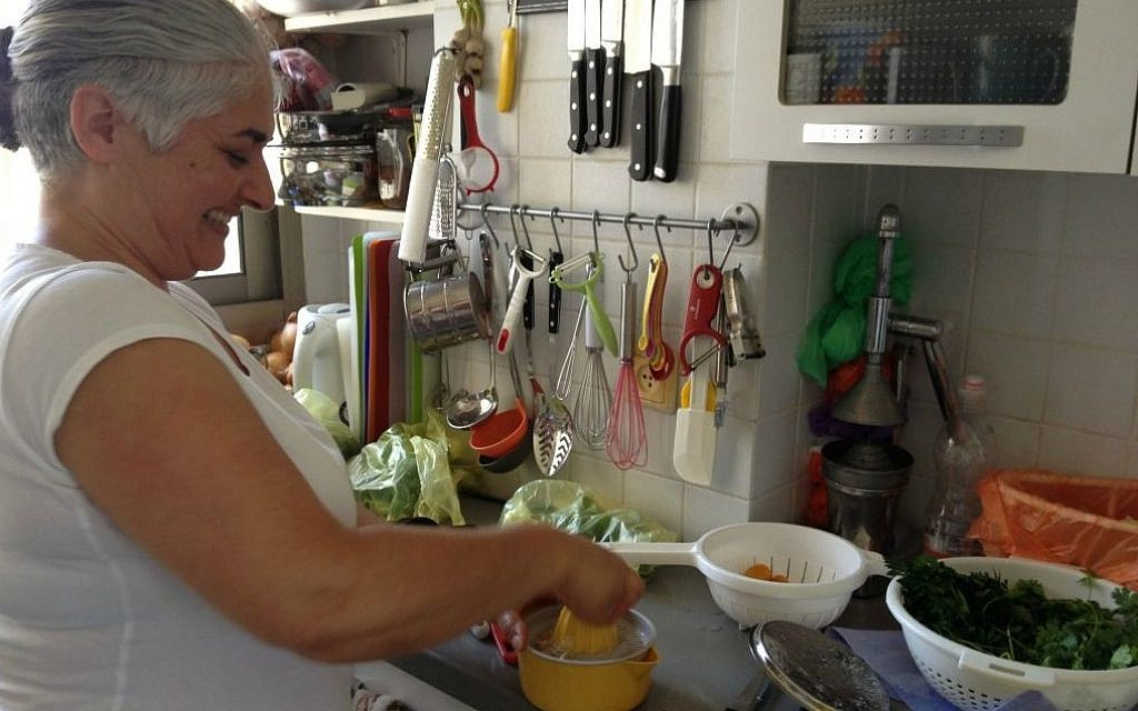 Orly Ziv in her compact but efficient kitchen (photo credit: Jessica Steinberg/Times of Israel)