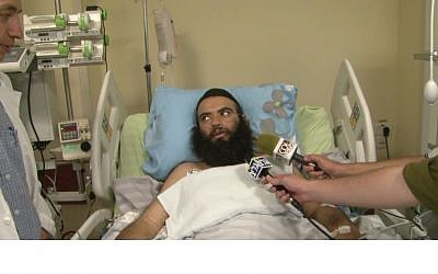 Rabbi Ovadia Isakov recovering in an Israeli hospital after being shot outside his home in Derbent. (photo credit: YouTube/Shneor Schiff )