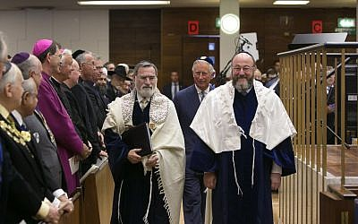Outgoing chief rabbi Jonathan Sacks (left), walking with Ephraim Mirvis (right) and Prince Charles (behind them in center). (photo credit: Yakir Zur)