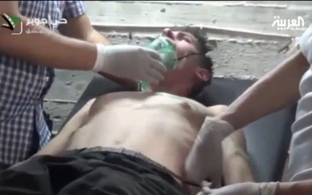 A young man receives medical treatment after what Syrian rebels claim was a chemical weapons attack in the Jobar neighborhood of Damascus on September 12, 2013 screen capture: YouTube)
