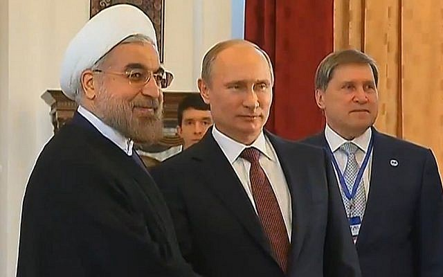 Russian President Vladimir Putin with his Iranian counterpart, Hassan Rouhani,  Friday, September 13, 2013 (photo credit: via YouTube)