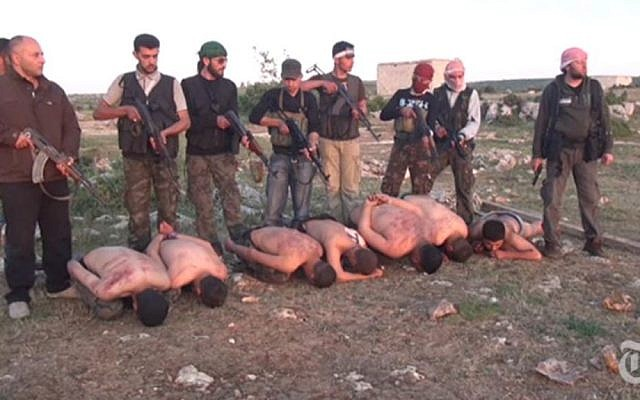 A video released by the New York Times shows Syrian rebels about to execute stripped and bound soldiers loyal to President Bashar Assad (photo credit: @MmeLenvie via Twitter/File)