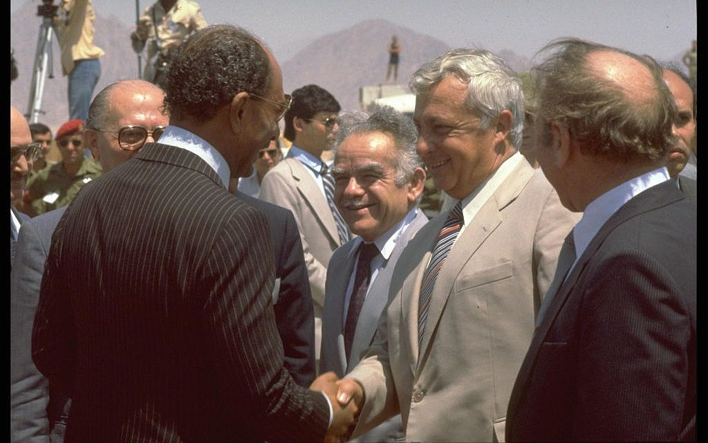 Agriculture Minister Ariel Sharon shaking hands with Egyptian President Anwar Sadat at a summit meeting held in Sharm e-Sheikh, June 4, 1981 (photo credit: GPO/Moshe Milner)