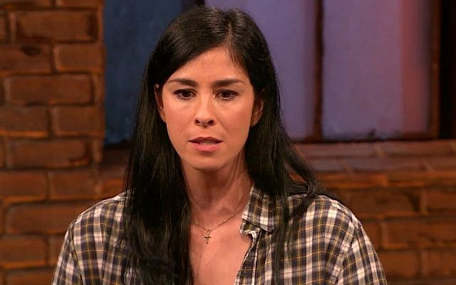 Sarah Silverman wears a necklace with a cross during a recent interview (via YouTube)