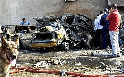 Security officials examine the site of a car bomb in the Suez Canal city of Ismailia, Egypt, Saturday Oct. 19, 2013. A car bomb exploded Saturday near an Egyptian military intelligence compound in the Suez Canal city of Ismailia, wounding several soldiers, security officials said, as militants appear to be expanding the scope of attacks beyond the restive Sinai Peninsula. (AP Photo)