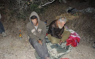 Suspects in an alleged antiquities theft ring after arrest near Khirbat Umm er-Rus. (photo credit: Israel Antiquities Authority)