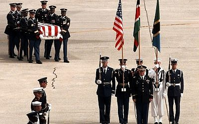 Soldiers of the Army's 3rd Infantry (The Old Guard) carry the remains of a victim of the bombing of the US Embassy in Nairobi, Kenya, to a ceremony at Andrews Air Force Base, Md., on Aug. 13, 1998. (photo credit: Tech. Sgt. Mark A. Suban, US Air Force/DoD).