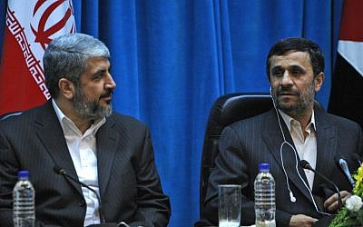 Hamas politburo chief Khaled Mashaal sits next to former Iranian president Mahmoud Ahmadinejad during a conference in Tehran, February 2010 (photo credit: AP/Vahid Salemi)