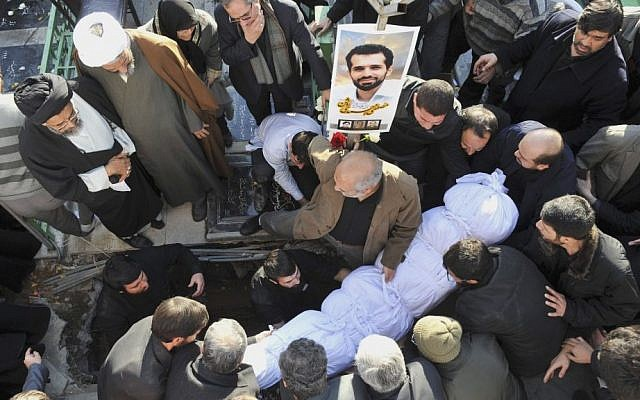 The shrouded body of Mostafa Ahmadi-Roshan, a chemistry expert and a director of the Natanz uranium enrichment facility in central Iran, is seen prior to burial in Tehran, Iran, January 2012 (photo credit: AP/Iranian Students News Agency/Mehdi Ghasemi)