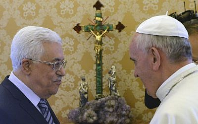 Pope Francis and Mahmoud Abbas talk during their private audience, at the Vatican, on Thursday, October 17, 2013. (photo credit: AP/Maurizio Brambatti, Pool)