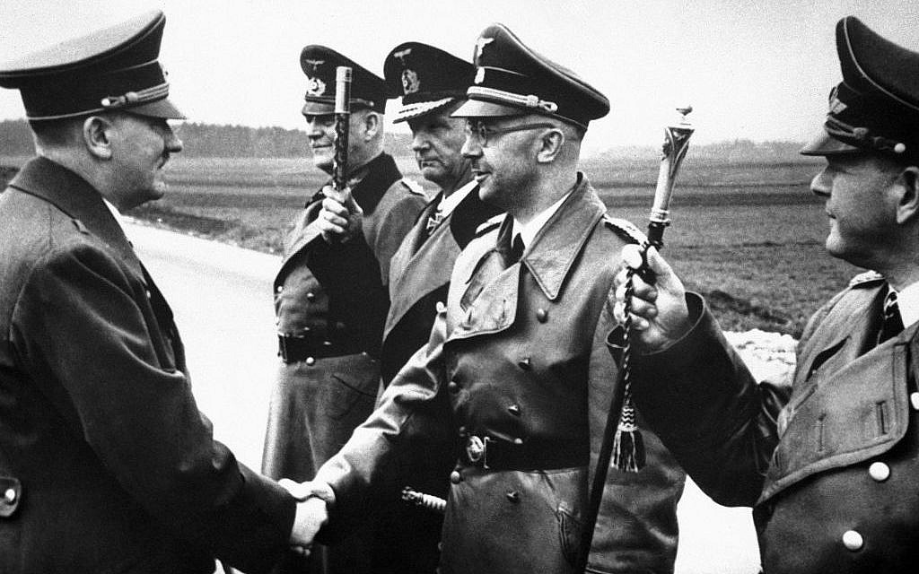 Adolf Hitler (left) shakes hands with Heinrich Himmler somewhere in Germany on May 18, 1944. From left to right: Hitler, Minister Field Marshal Wilhelm Keitel, Admiral Karl Doenitz, Himmler and Field Marshal General Erhard Milch. (AP)