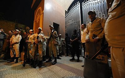 Illustrative photo of Egyptian security forces standing guard at a Coptic Christian church, October 20, 2013 (photo credit: AP/Amr Mohsen)