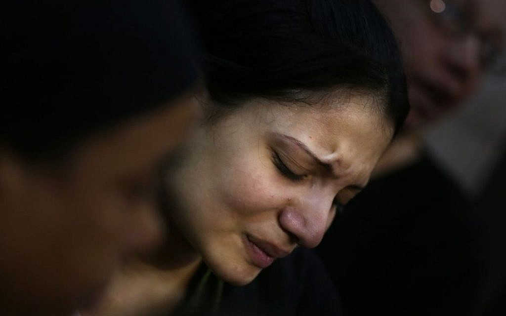 An Egyptian woman mourns during the funeral of several Coptic Christians who were killed late Sunday, in Warraq's Virgin Mary church in Cairo, Egypt, on Monday (photo credit: AP/Khalil Hamra)