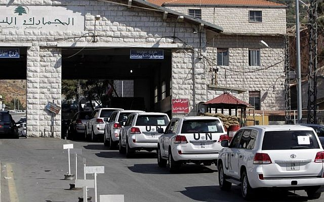 A convoy of inspectors from the Organization for the Prohibition of Chemical Weapons prepares to cross into Syria at the Lebanese border crossing point of Masnaa, eastern Bekaa Valley, Lebanon, on Tuesday, October 1, 2013. (photo credit: AP/Bilal Hussein)