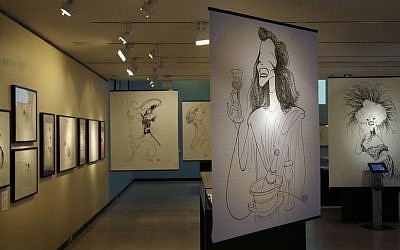 Drawings by Al Hirschfeld are displayed in an exhibit on the artist at the Library for the Performing Arts in New York, Wednesday, Oct. 16, 2013. (photo credit: AP Photo/Seth Wenig)