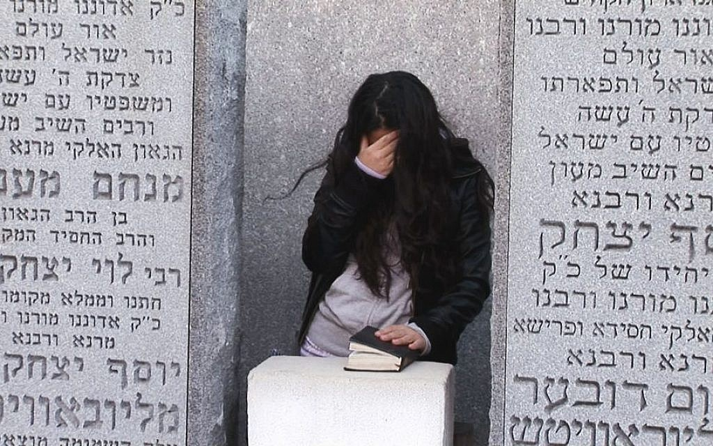 A BMC Seminary student at the Rebbe's grave. (photo credit: Courtesy of DLI Productions)