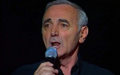 Charles Aznavour at a 1997 concert in Paris (screen capture: YouTube)