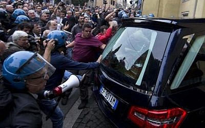 Rioters greet the hearse carrying the body of Nazi war criminal Erich Priebke in Rome, Italy, on Tuesday (photo credit: @GalvaniM via Twitter)