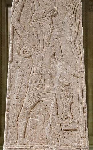 The Baal stele from Ugarit, currently displayed in the Louvre. (photo credit: Marie-Lan Nguyen, Public domain, via Wikimedia Commons)