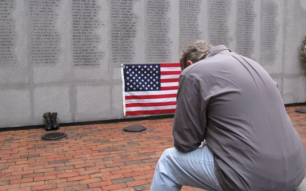 Former Marine Ed Ayers of Scranton, Penn., hangs his head and weeps at the Beirut Bombing Memorial in Jacksonville, NC, on Wednesday (photo credit: AP/Allen G. Breed)