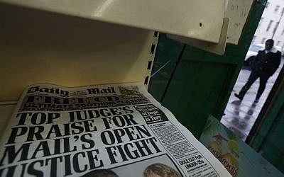 Copies of Britain's Daily Mail newspaper are offered for sale at a newsagent in London, Thursday, Oct. 3, 2013 (photo credit: AP Photo/Lefteris Pitarakis)