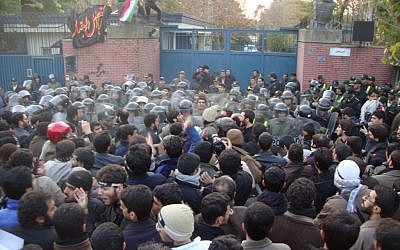 A view of the mob that beset the Iranian embassy in Tehran in November 2011 (photo credit: CC BY-SA Americophile, Wikimedia Commons)