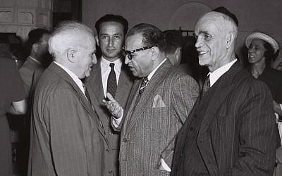 Iranian Minister Plenipotentiary Reza Safinia, who represented Tehran in Israel, chats with then-prime minister David Ben-Gurion and at a party in Jerusalem, June 1, 1950 (photo credit: Teddy Brauner/GPO)