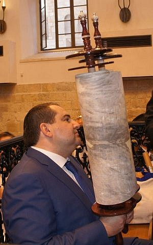 Kiev Jewish community leader Alexander Levin with a Torah scroll (photo credit: courtesy)